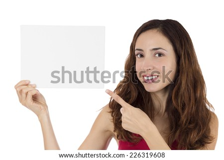Woman pointing to a blank marketing poster - stock photo