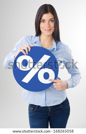 woman pointing to a blue board - stock photo