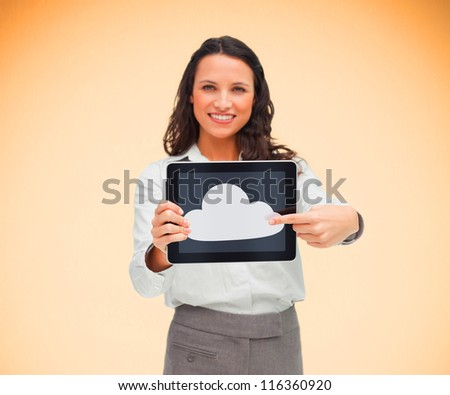Woman pointing to cloud symbol on her digital tablet and smiling