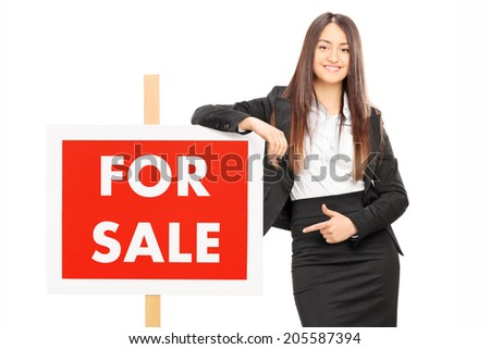 Woman pointing towards a panel isolated on white background