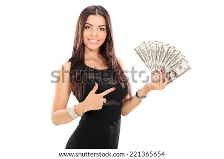Woman pointing towards a stack of money with her finger isolated on white background - stock photo