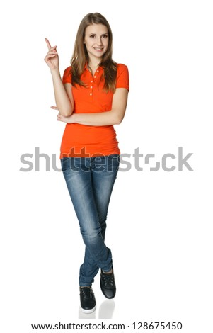 Woman pointing up standing in full length, isolated on white - stock photo