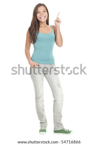 Woman pointing up standing in full length - isolated on white background. Young Asian Caucasian female model. - stock photo