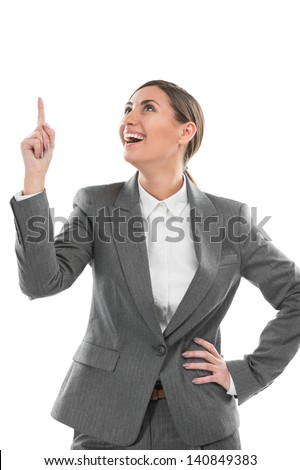 Woman pointing upwards having a business idea - isolated over a white background