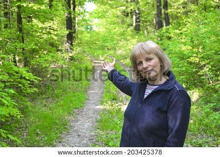 Woman points direction in the forest