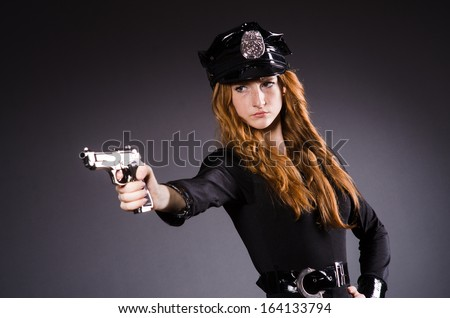 Woman police office with gun