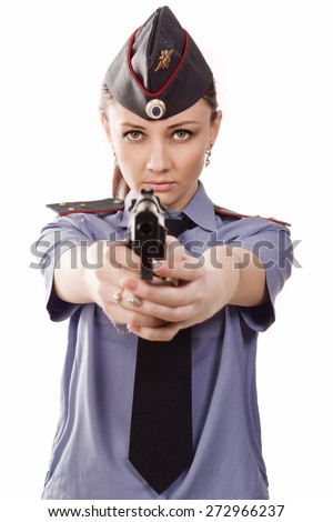 Woman police officer pointing a Gun at the Camera