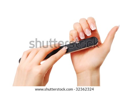 Woman polishing fingernails with the nail file