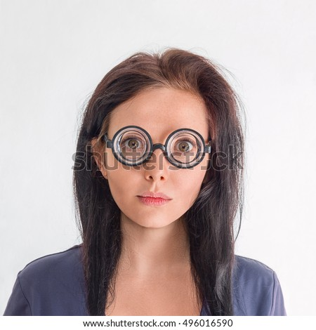 Woman portrait in crazy clown glasses isolated over white