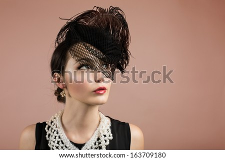 Woman Portrait in Vintage Black Hat with a Veil and Feather. Retro Style.