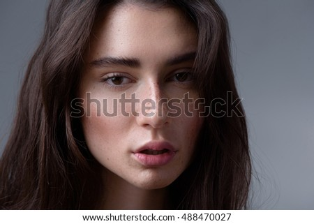 woman portrait isolated on light grey background with copyspace