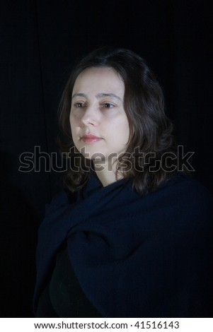 woman portrait on a black background - stock photo