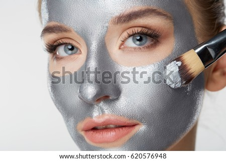 Woman portrait skin care health healthy silver mask close up white