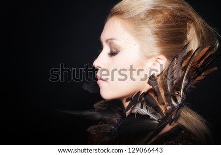 Woman portrait with feather