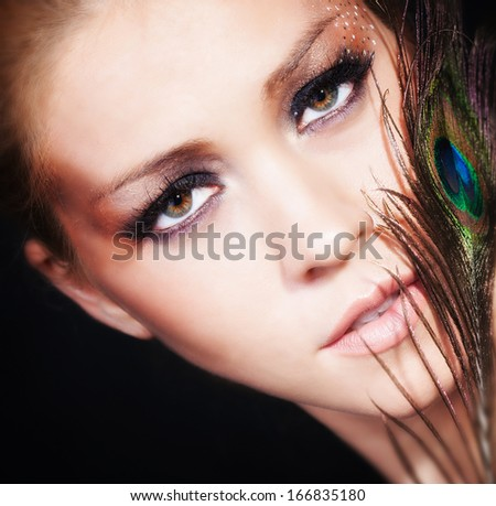 Woman portrait with feather - stock photo