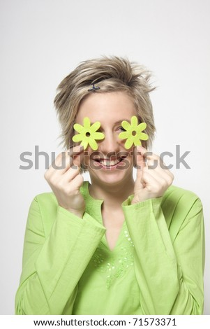 Woman portrait with green flowers - wellness concept - stock photo