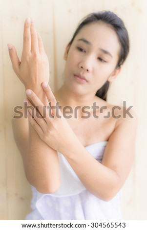 Woman portrait with wash hand acting on blur wood background
