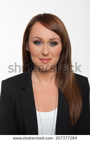Woman poses for a passport photo - stock photo