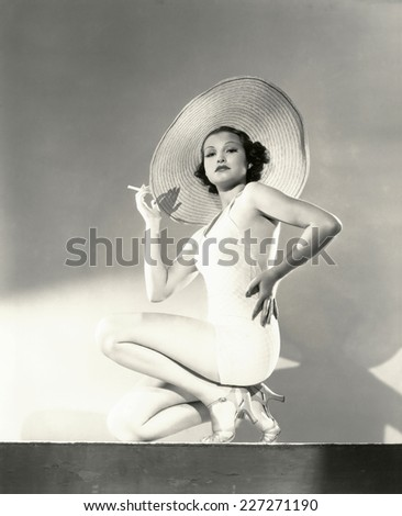 Woman posing in a wide brim hat - stock photo