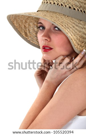 Woman posing in straw hat - stock photo