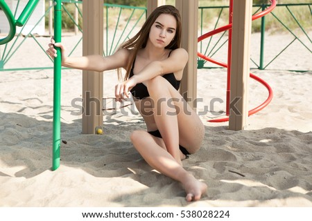 Woman posing on the sand.