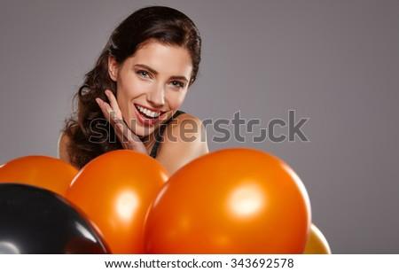 woman posing with balloons. Girl smiling , looking at camera. - stock photo