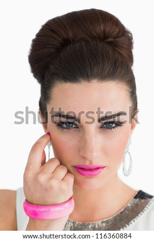 Woman posing with beehive and pink lips on white background - stock photo