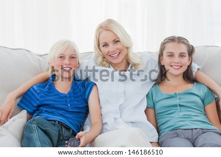 Woman posing with children sitting on couch