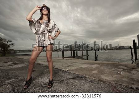 Woman posing with fashionable clothes and accessories