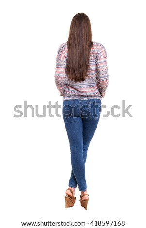 Woman posing with her back faced to camera, isolated over copy space background - stock photo