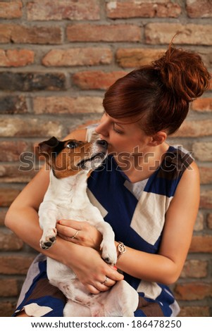 Woman posing with her dog - stock photo