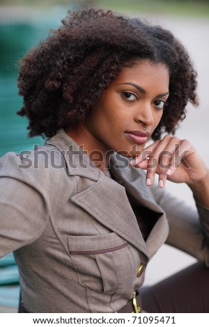Woman posing with her hand under her chin - stock photo