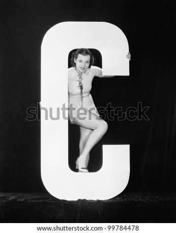 Woman posing with huge letter C - stock photo