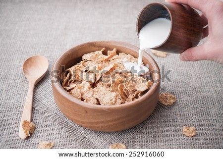 Woman Pouring Milk In A Cereal - stock photo