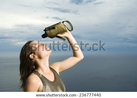 Woman Pouring Water on her Head