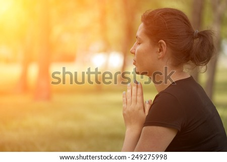 Woman practice meditation in park - stock photo