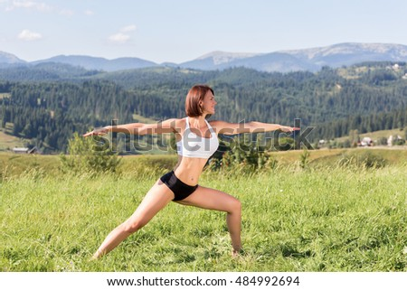 woman practices yoga in the mountains