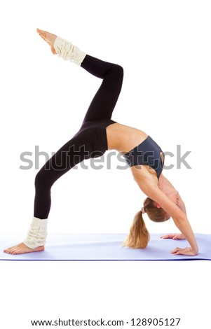 woman practices yoga on a white background, isolated.