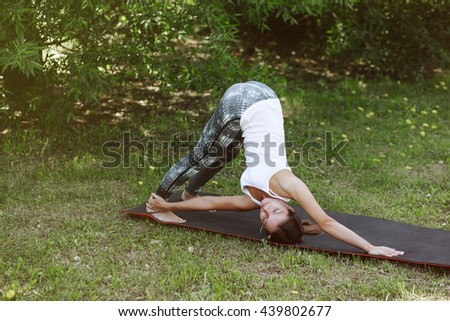 Woman practicing advanced yoga at the outdoor. A series of yoga poses