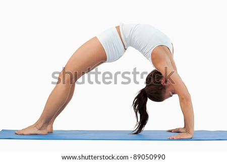 Woman practicing gymnastic against a white background