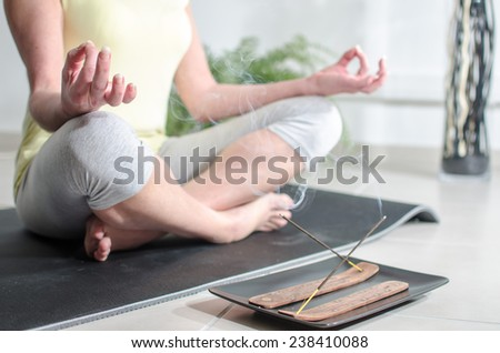 Woman practicing meditation - stock photo