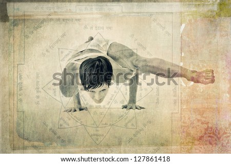 Woman practicing yoga hand balance in an ancient yoga yantra. - stock photo