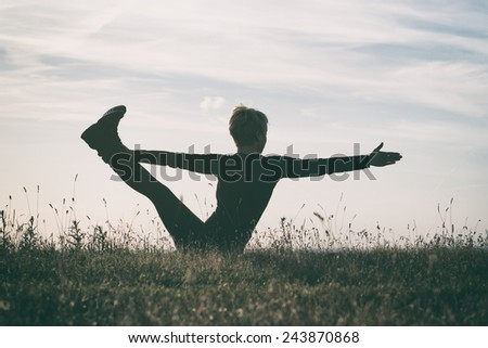 Woman practicing yoga,intentionally toned image.Yoga