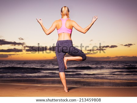 Woman practicing yoga pose on the beach at sunset  - stock photo