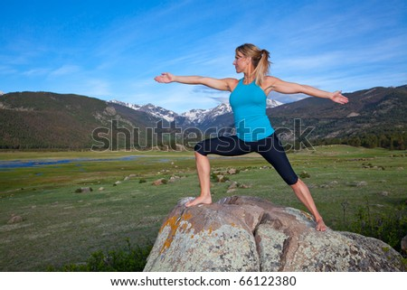 Woman pratices Yoga in the Colorado Rocky Mountains