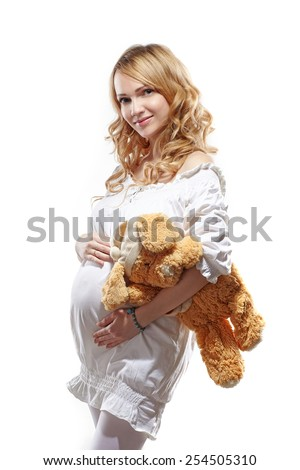 woman pregnant on white background with toy - stock photo