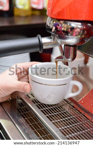 Woman preparing coffee, close up