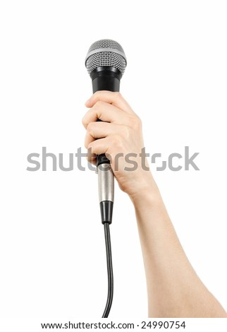 Woman presenter holding a microphone in hand - stock photo