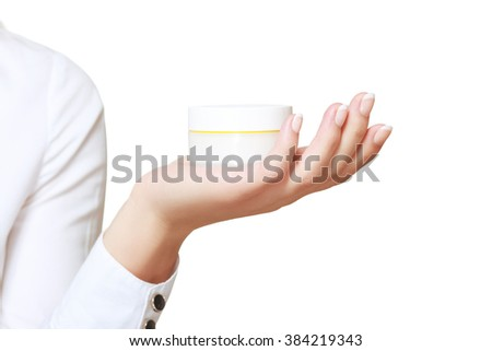 Woman presenting a hand cream close up isolated