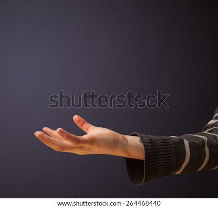 Woman presenting empty space - stock photo